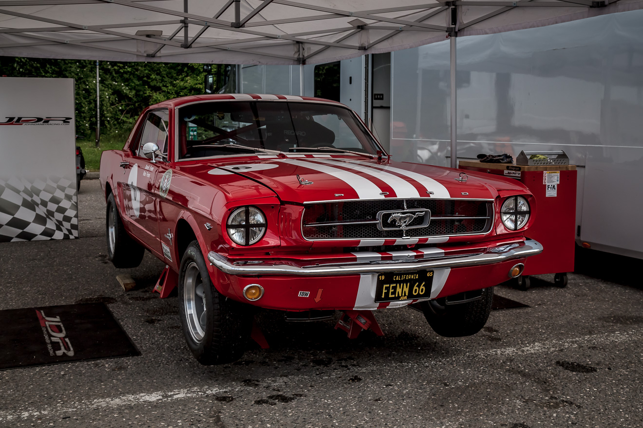 Red 1965 Ford Mustang in the pits at Brands Hatch