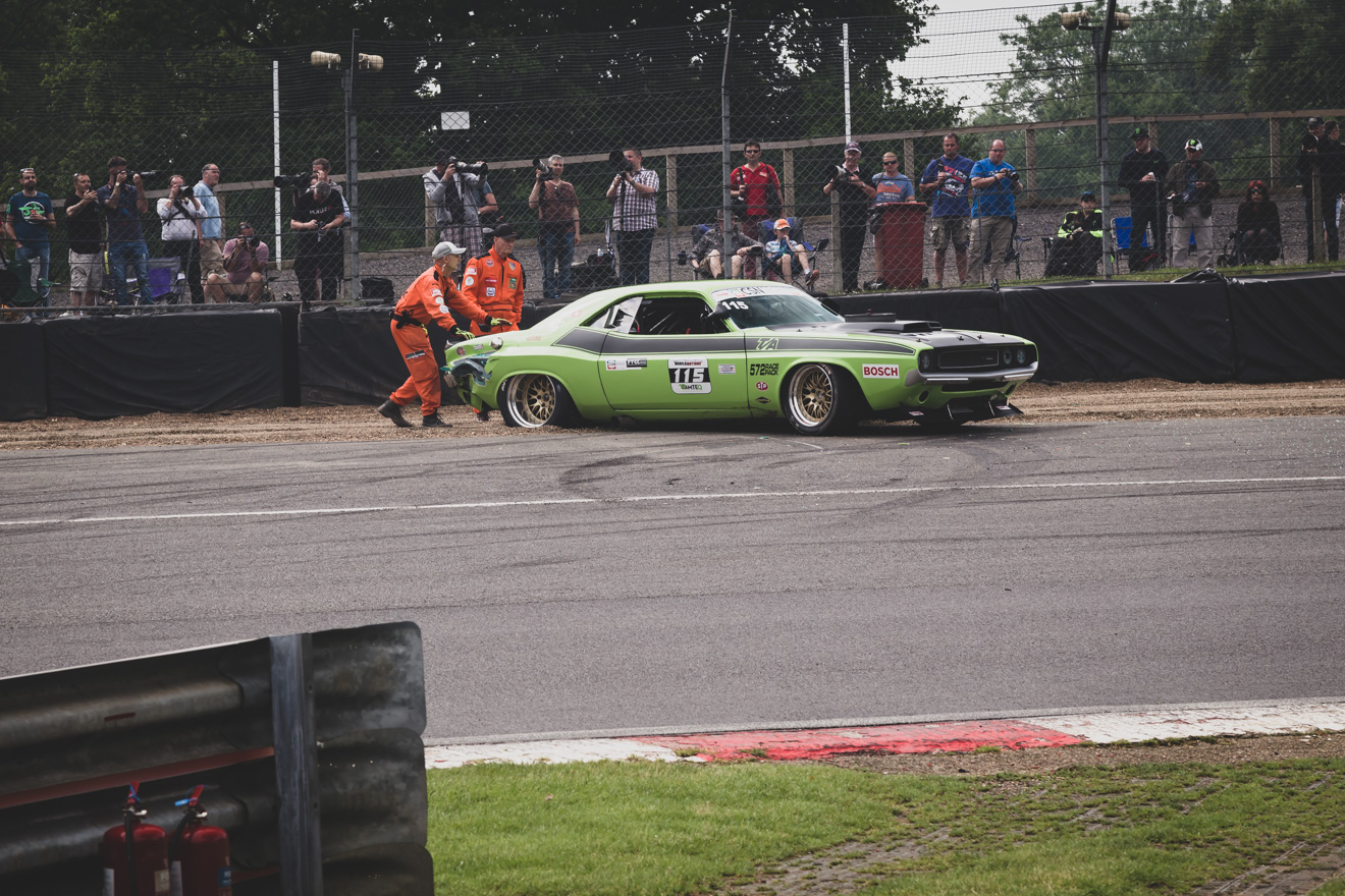 Marshals pushing Dodge Challenger TA back onto the track